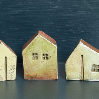 Three Small Ocre Houses by Vesna Gusman